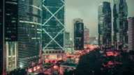 Lights flash through the skies of downtown Hong Kong.