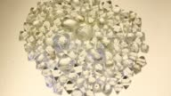 Lights play off rough diamonds as they sit on a sorting table during the grading process at the Yakutsk Diamond Trading Enterprise operated by Alrosa...
