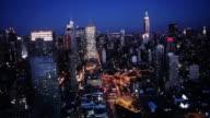 Lights shine in New York City at night.