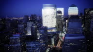 Lights shine on the office buildings of New York City.