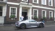 Limited edition super car Porsche 918 Spyder with Dubai number plates parked outside The Arts club Dover Street in London UK