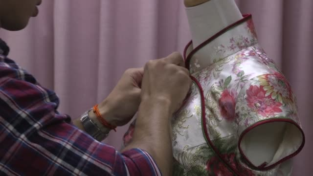 Lin Chinte is among a handful of craftsmen in Taiwan who still specialise in handmaking the qipao a high collar figure hugging garment which was once...