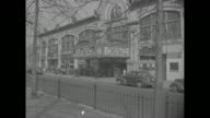 MS line of adults and children at box office of the Scarsdale Theatre Showplace Westchester / closer shot of people in line // LS people in line down...