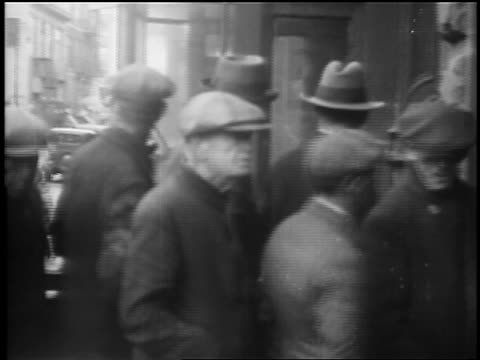 B/W 1929 line of homeless men waiting to be fed / Great Depression / newsreel