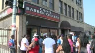 WGN Line Outside Barber Shop For Free Haircuts on August 24 2013 in Chicago Illinois