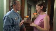 SLO MO MS Lineman and woman talking outside house / Austin, Texas, USA