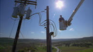 CS SLO MO WS LA PAN Lineman in bucket truck approaching power lines / Canyon Lake, Texas, USA