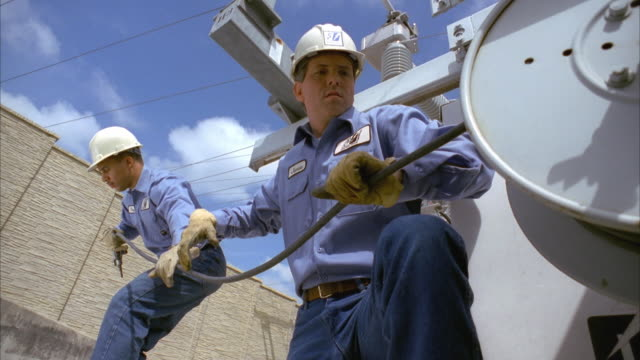 SLO MO MS LA Linemen unraveling power lines at substation / Cedar Park, Texas, USA