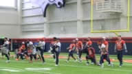 A lingering winter snow storm coverd the Denver Broncos practice field so the team used the indoor practice facility to go through drills on the...