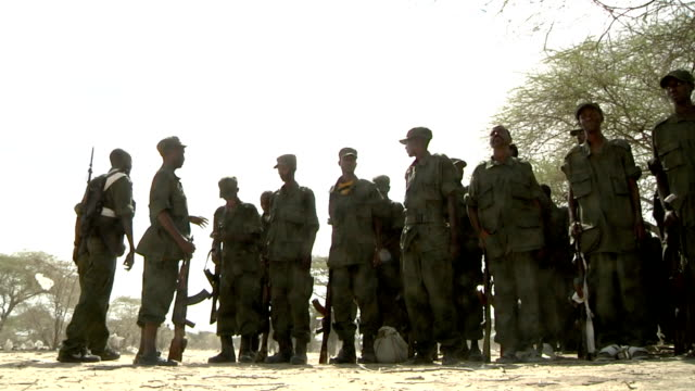 lining up and preparing to leave Somali militia men on July 31 2011 in Dhoobley Somalia