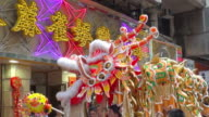 MS PAN TD Lion dance performance on street on Chinese New Year AUDIO / Hong Kong, Special Administrative Region, China