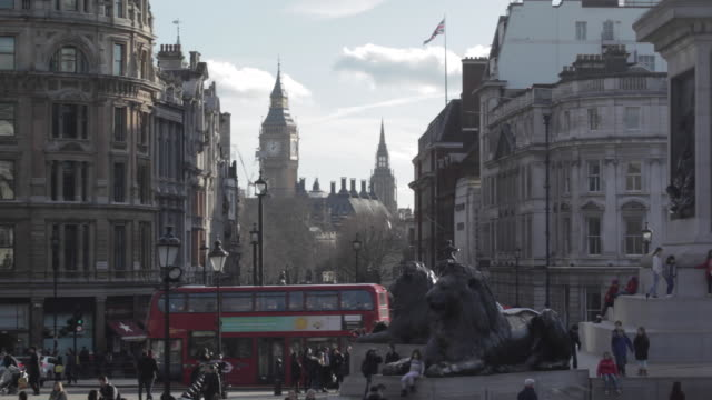 Lions, Big Ben Clocktower and Red Buses, Trafalgar Square, Westminster, London, England, UK