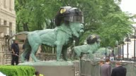 WGN Lions In Front Of The Art Institute Of Chicago Lion Statutes Wearing Chicago Blackhawks Helmet on June 12 2013 in Chicago Illinois