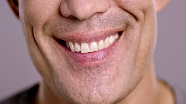 Lips of a laughing Asian man