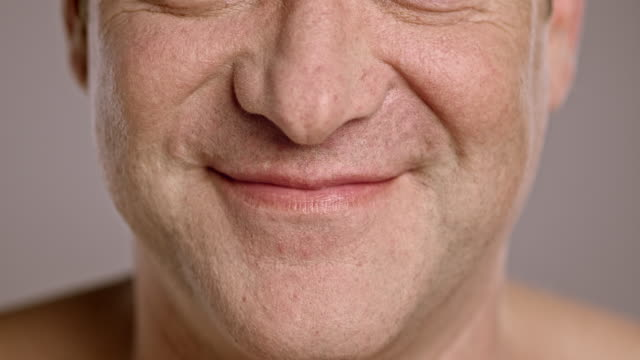 Lips of a smiling middle-aged Caucasian man