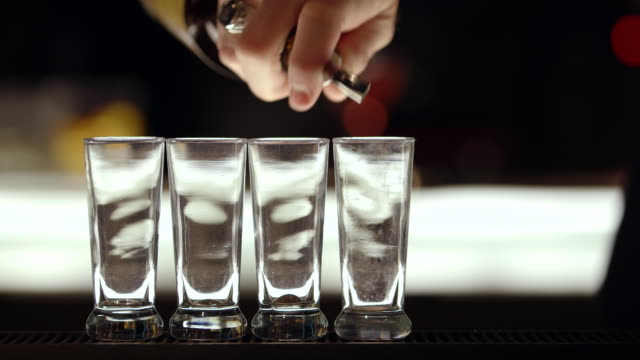 MS liquid  being pored into shot glasses