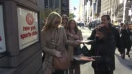 Lisa Kudrow signs for fans while departing from the SiriusXM Satellite Radio studio on November 03 2014 in New York City