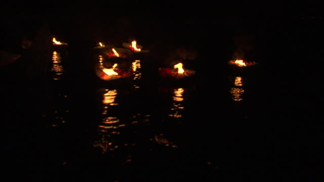 Lit devotional boats float down river as part of Ganga Aarti festival, Haridwar Available in HD.