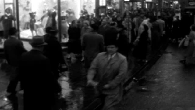 New book 'The Establishment' looks at the aristocracy in Britain LIB London EXT B/W TRACKING shot of Christmas shoppers along street Woman running...
