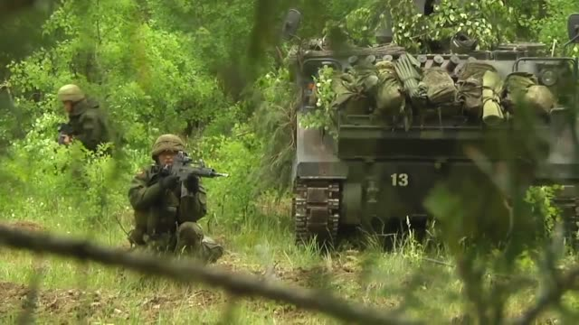 Lithuanian Soldiers defend their positions at Saber Strike 2014