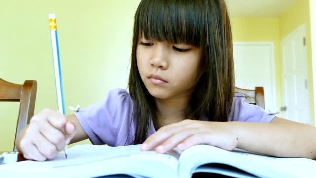 Little Asian girl doing her homework