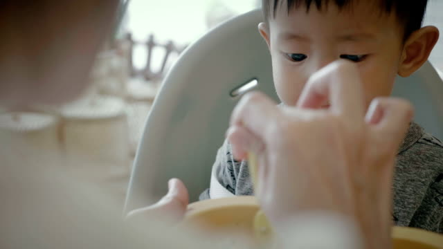 A Little Baby (6-11months) Boy Eating