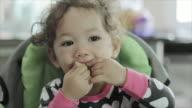 Little baby girl toddler eating her breakfast