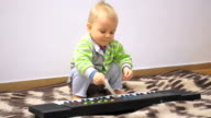Little baby with electric piano