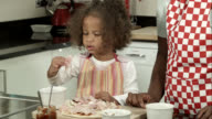 HD: Little Biracial Girl Eating Pizza Toppings Supervised By Carer/ Mother
