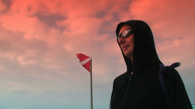 Little black riding hood and diver-down flag at sunset