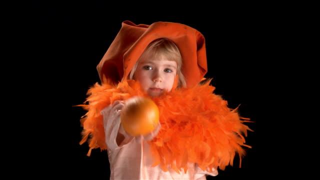 little blond girl in orange costume
