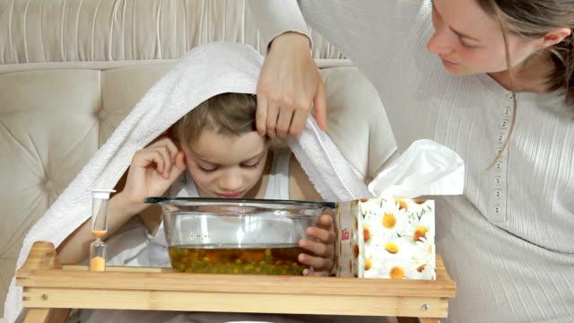 little boy breathes vapors herbal decoction