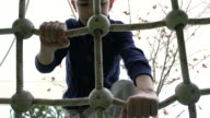Little boy climbing at the playground