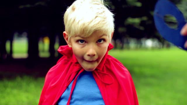 Little boy doing funny mines.