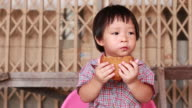 Little boy eating Banana Cake