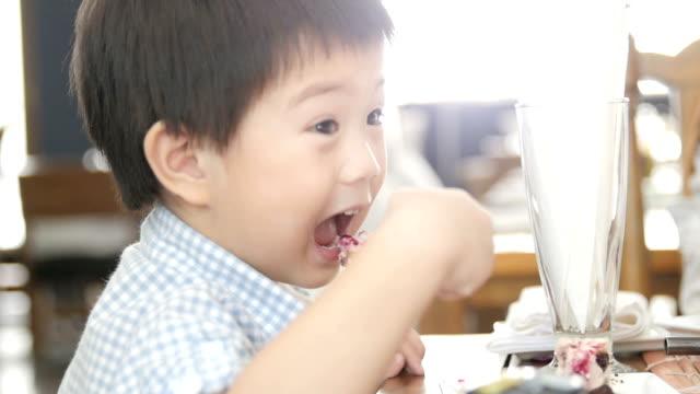 Little boy Eating Yummy cake.