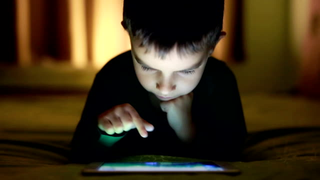 Little Boy playing on digital tablet
