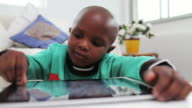 Little boy plays games on a digital tablet
