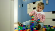 Little Boy Stacking Up Toy Blocks