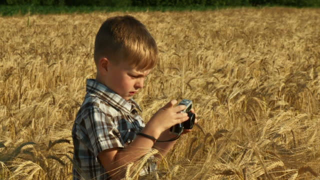 HD SLOW-MOTION: Little Boy Taking Pictures