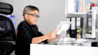 Little boy using tablet and smart phone