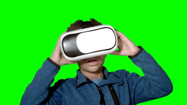 HD: Little Boy Using Virtual Reality Simulator