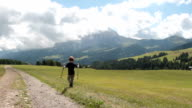 Little boy walking on Seiser Alm - Alto Adige