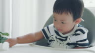 Little boy wiping the table