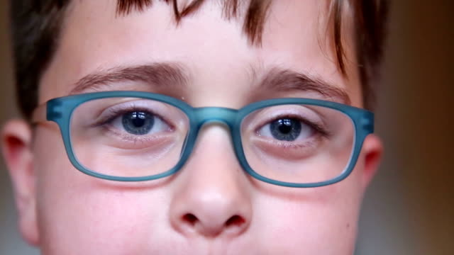 little boy with glasses, close-up