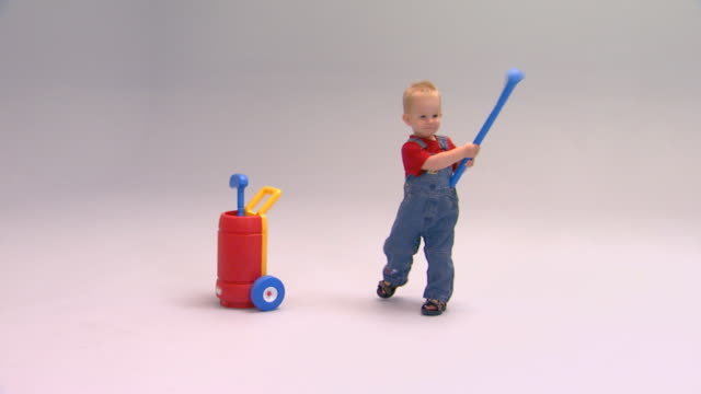 Little boy with toy golf set