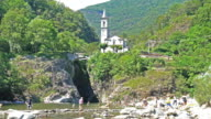 Little church on a rock over a river,