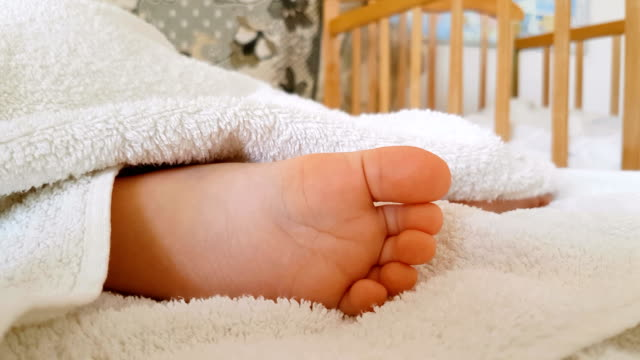 Little foot of sleeping baby