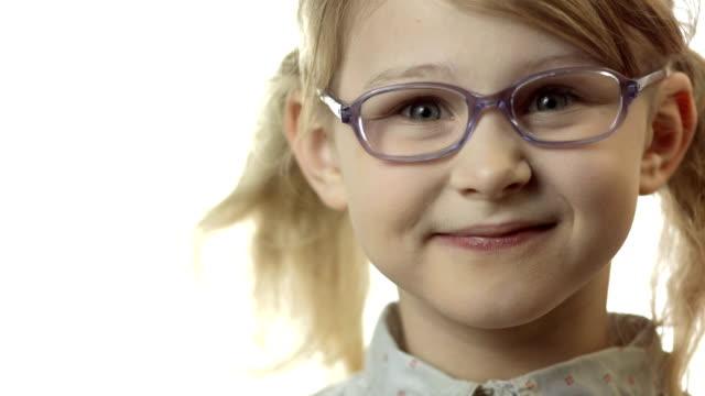 HD: Little Girl Adjusting Glasses On Her Nose