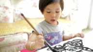 DS Little girl attempts her first chinese calligraphy brushstrokes /Xi'an, Shaanxi, China